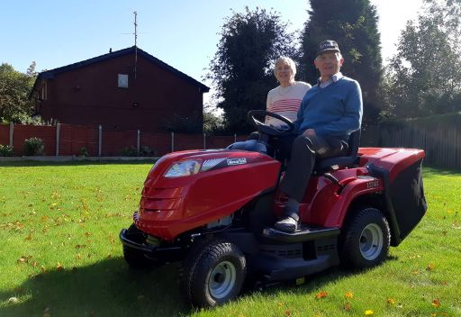 Roy & Marjorie on their new ride-on mower